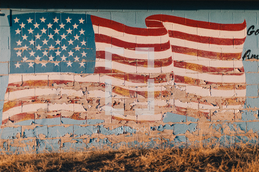 American flag painted on a rural gas station building