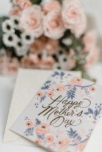mother's day card and flower arrangement