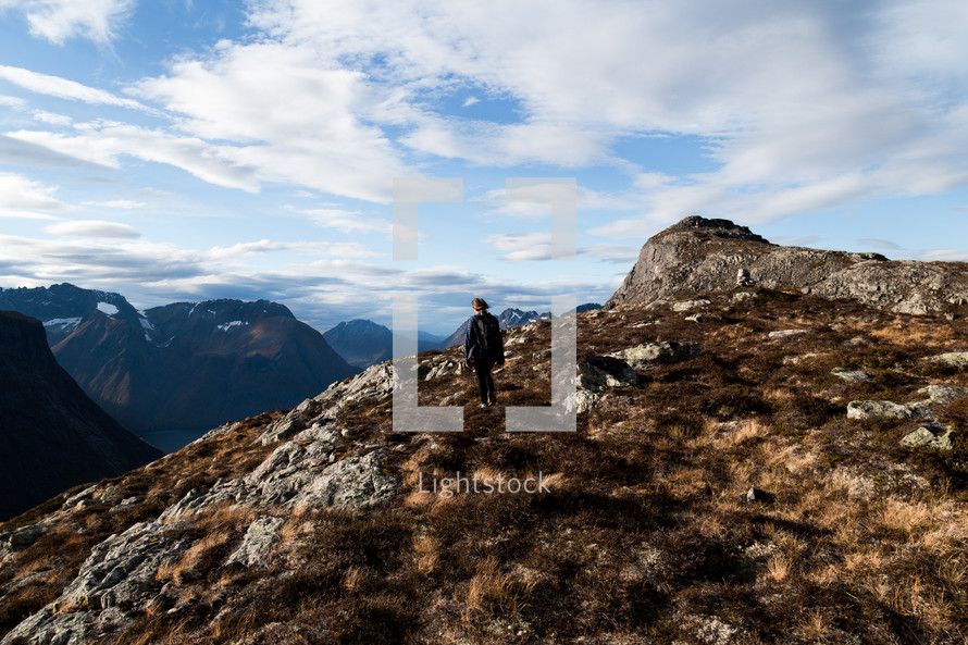a person standing on a mountaintop