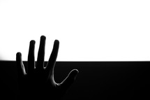 raised hand and black and white background