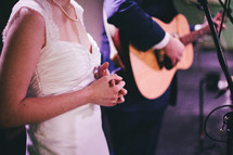 A bride and groom singing.