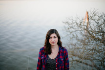 Woman standing by a lake.