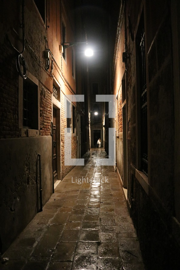 narrow alley at night in Venice