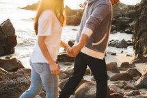 couple walking holding hands on a beach