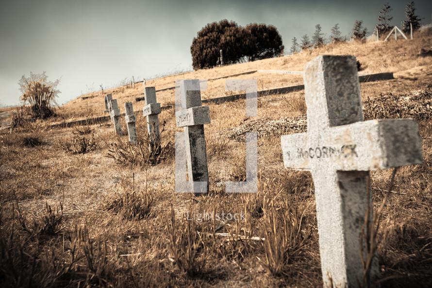 Cross headstones on hillside cemetary.
