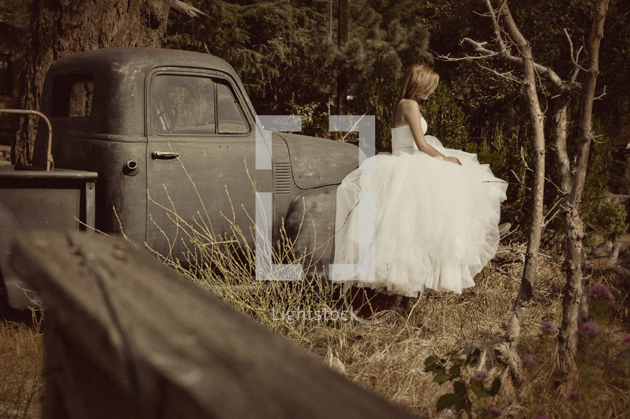 a bride sitting on an old truck classic country wedding marriage
