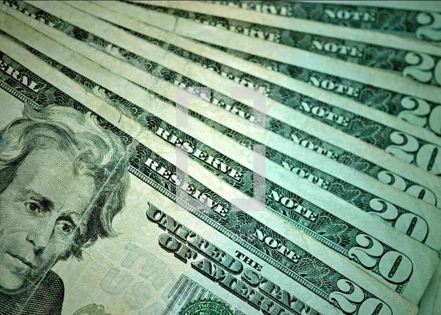 Money--nice crisp twenty dollar bills of United States currency.
