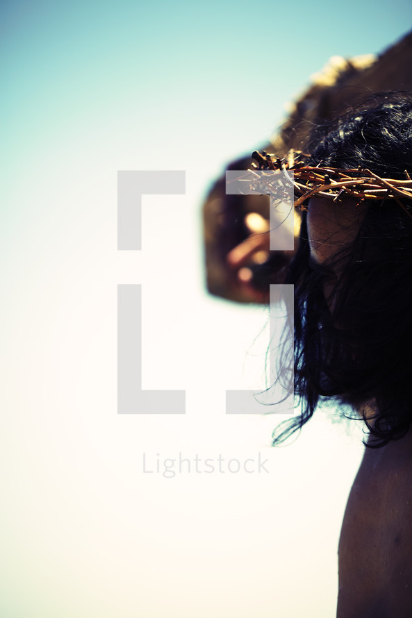Jesus on the cross with a crown of thorns on his head
