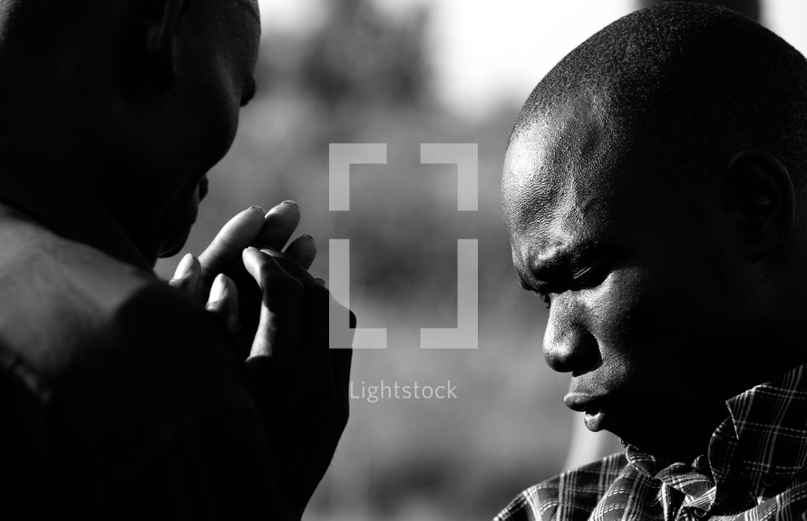 Men in fervent prayer