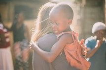missionary hugging a child in Kenya