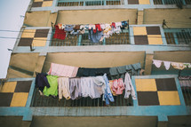 clothes hanging on a clothes line and balcony