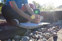 teen boy praying on railroad tracks