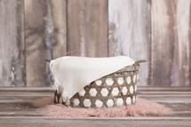 basket on a pink fur rug