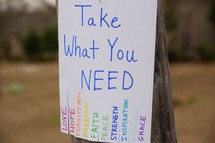 Take What you need flyer hanging on a telephone pole