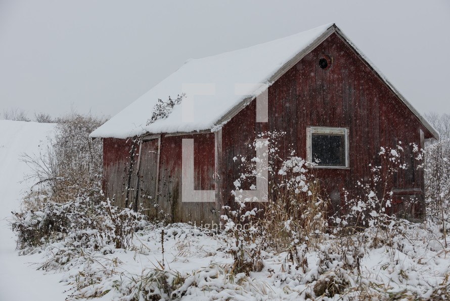 snow on a red barn