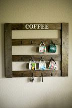 coffee cups hanging on hooks