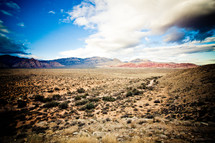 white clouds and blue sky over desert mountains in Nevada