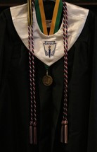 cap and gown with medals and ribbons