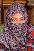 Eyes of a shrouded Ethiopian muslim woman [For more search Ethnic Face Smile]