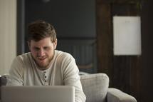 man looking at a computer screen.