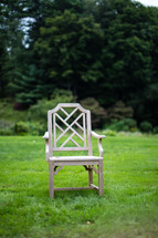 Empty chair in the grass.