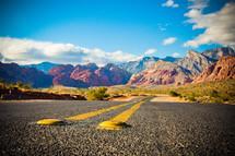 open road through the Nevada desert mountains