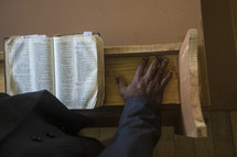 preacher at the pulpit with an open Bible