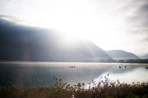 rays of morning sunlight on a lake in France