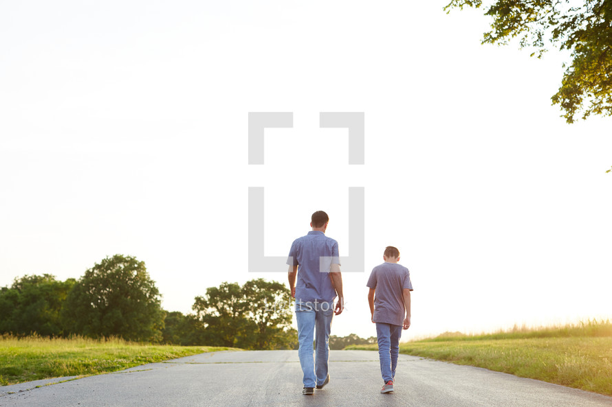 a father and son walking and talking together
