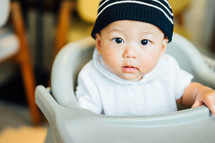 infant in a high chair