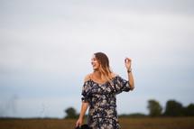 woman walking through a field