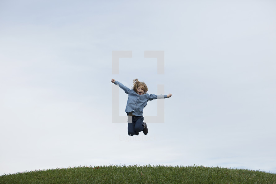 a girl leaping in the air