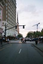 Pedestrians walking along a city street.