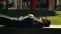 businessman resting in sunlight
