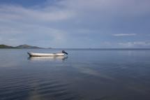Empty boat in ocean.