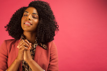African American woman with praying hands