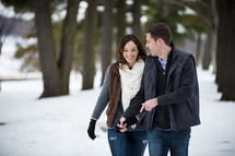 couple walking outdoors in the snow