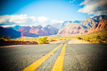 open road through the Nevada desert mountains