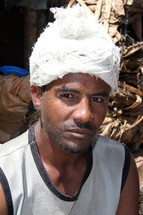 An Ethiopian man working in a cotton mill  [For similar search for Ethnic Face Smile]