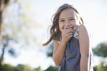 a giggling girl child outdoors