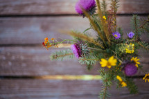 wildflowers in a vase on picnic table