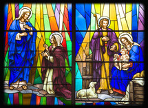 Stained glass windows in a church depicting the birth of Christ