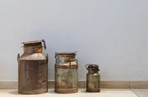 old rusty milk cans
