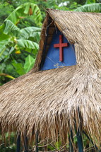 Rural christian church with grass thatch roof