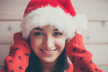 woman in a santa hat and Christmas sweater