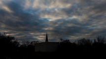 silhouette of a steeple at dusk