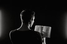 a man reading from a Bible