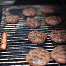 hamburgers and hotdogs on the grill