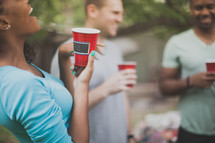 friends in conversation at a cookout