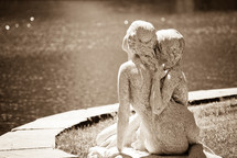 stone statue of women hugging